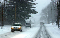 Motorists navigate a highway during a winter snow storm, February 16. 2003, in Buckingham, Pennsylvania. The Philadelphia region is expected to get from 12-20 inches of snow from a major winter storm by Monday evening. (Photo by William Thomas Cain/photodx.com)