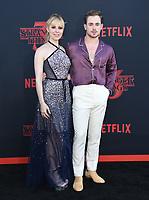 "28 June 2019 - Santa Monica, California - Cara Buono, Dacre Montgomery. ""Stranger Things 3"" LA Premiere held at Santa Monica High School. <br /> CAP/ADM/BT<br /> ©BT/ADM/Capital Pictures"