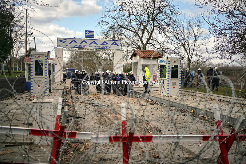 Pictured: Greek riot police seen from the Turkish side of the border in Andrianoupolis. Sunday 01 March 2020<br /> Re: Clashes between migrants and riot police at the Greek-Turkish border of Kastanies near Evros, Greece