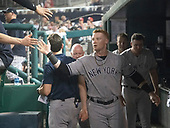 New York Yankees pinch-hitter Clint Frazier celebrates with teammates after scoring his team's fourth run in the seventh inning against the Washington Nationals at Nationals Park in Washington, D.C. on Monday, June 18, 2018.  This is the make-up game that was scheduled to be played on May 16, 2018 that was postponed due to rain.<br /> Credit: Ron Sachs / CNP<br /> (RESTRICTION: NO New York or New Jersey Newspapers or newspapers within a 75 mile radius of New York City)