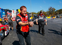 Oct 14, 2019; Concord, NC, USA; NHRA pro mod driver Steve Jackson celebrates after clinching the 2019 championship during the Carolina Nationals at zMax Dragway. Mandatory Credit: Mark J. Rebilas-USA TODAY Sports