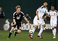 Dax McCarty (10) of D.C. United moves the ball away from Omar Gonzalez (4) of the Los Angeles Galaxy during an MLS match at RFK Stadium, on April 9 2011, in Washington D.C.The game ended in a 1-1 tie.
