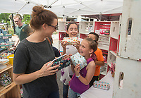 NWA Democrat-Gazette/BEN GOFF @NWABENGOFF<br /> Adrianne McGinnis and daughter Meadow McGinnis (fore), 10, of Springdale shop with friends Lucia Guzman-Barron, 12, and her brother Mateo Guzman-Barron, 10, of Rogers, at the Sewing with Squeak booth Saturday, May 12, 2018, during The Little Craft Show in downtown Springdale.