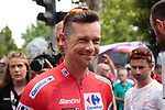 Race leader Red Jersey Nicolas Roche (IRL) Team Sunweb at sign on before the start of Stage 3 of La Vuelta 2019 running 188km from Ibi. Ciudad del Juguete to Alicante, Spain. 26th August 2019.<br /> Picture: Colin Flockton | Cyclefile<br /> <br /> All photos usage must carry mandatory copyright credit (© Cyclefile | Colin Flockton)