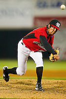 Cody Buckel #22 of the Hickory Crawdads follows through on his delivery against the Augusta GreenJackets at L.P. Frans Stadium on April 29, 2011 in Hickory, North Carolina.   Photo by Brian Westerholt / Four Seam Images