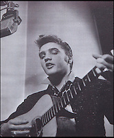 BNPS.co.uk (01202 558833)<br /> Pic: Julien's/BNPS<br /> <br /> ****must use full byline****<br /> <br /> Elvis in the recording studio.<br /> <br /> Well, it's a one for the money...<br /> <br /> The most famous contrct in Rock &amp; Roll has emerged for sale.<br /> <br /> In November, Col. Parker successfully persuaded RCA Victor to buy Elvis Presley' contract from Sun Records for $40,000.<br /> <br /> After Elvis signed the official agreement his career went from strength to strength and it was with RCA Victor he released his most famous tracks.<br /> <br /> The document has survived the last 59 years in pristine condition and features signatures by Elvis and his parents Vernon and Gladys Presley.<br /> <br /> It will go under the hammer at Julien's Auctions in Los Angeles where it is estimated to fetch &pound;14,700, but experts believe it could reach &pound;23,500.