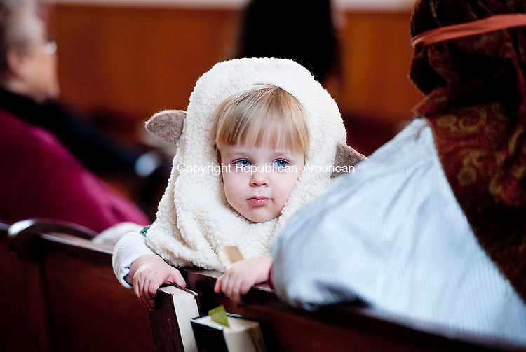 BARKHAMSTED,  CT-122114JS10- One-year-old Charlie Rhodes of WInsted, dressed as a sheep,  looks around the congregation prior during the17th annual Christmas Pageant held Sunday at the First Congregational Church of Barkhamsted. <br /> Jim Shannon Republican-American