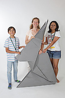 OrigamiUSA 2016 Convention at St. John's University, Queens, New York, USA. Oversized 9' x 9' paper folding zaevent. First timers. Left to right: Anthony Cameron, TX, unknown, Lolita Dsouza, GA.
