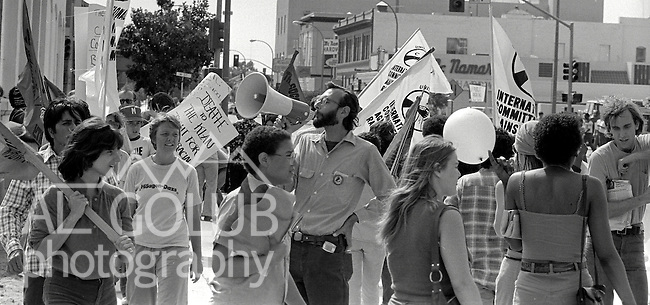 Merced CA--The Ku Klux Klan attempted to hold a big event in Merced Saturday, June 6, 1981.  Merced city council had approved a one-hour marching permit.  When the Klan showed up--with white robes and hoods--a crowd of several hundred interested Mercedian and members of the International Committee Against Racism (INCAR) appeared and were kept separate from the Klan by the Merced Police. .Michael Leonard and Robert Wyer were planning to lead the march.  The Invincible Empire and the Untied Klans of America sponsored the march.  Grand Klaliff Michael J. Leonard is from San Pablo.  Grand Dragon Robert L. Wyer is from the Fresno-Clovis area. June 06, 1981 Photo by AL GOLUB / Golub Photography.