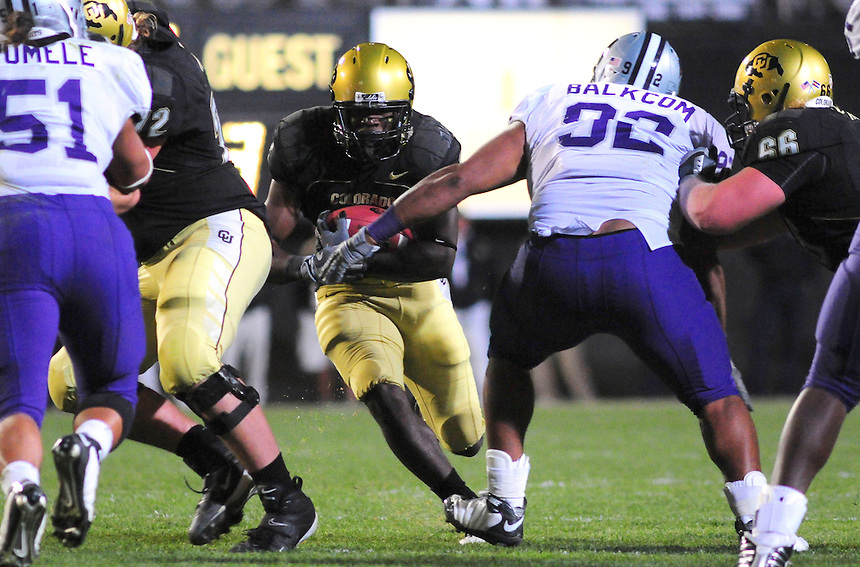 18 October 08: Colorado running back Darryl Scott looks for a hole as he rushes against Kansas State. The Colorado Buffaloes defeated the Kansas State Wildcats 14-13 at Folsom Field in Boulder, Colorado.