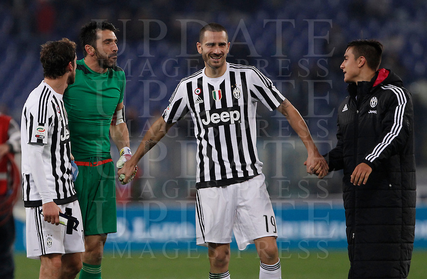 Calcio, Serie A: Lazio vs Juventus. Roma, stadio Olimpico, 4 dicembre 2015.<br /> Juventus' players, from left, Claudio Marchisio, Gianluigi Buffon, Leonardo Bonucci and Paulo Dybala celebrate at the end of the Italian Serie A football match between Lazio and Juventus at Rome's Olympic stadium, 4 December 2015. Juventus won 2-0.<br /> UPDATE IMAGES PRESS/Isabella Bonotto