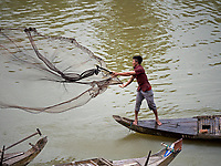 Casting the net at a small waterway close to the Tonle Sap Lake near Battambang, Cambodia