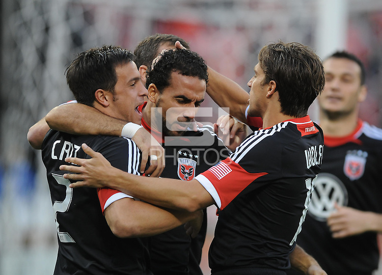 D.C. United forward Dwayne de Rosario (7) celebrates his score in the first minute of the game with teammates Josh Wolff (right) and Danny Cruz (left). D.C. United defeated Toronto FC 3-1 at RFK Stadium, Saturday May 19, 2012.