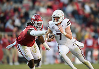NWA Democrat-Gazette/CHARLIE KAIJO Arkansas defensive lineman McTelvin Agim (3) grabs onto Mississippi State quarterback Tommy Stevens (7), Saturday, November 2, 2019 during the third quarter of a football game at Donald W. Reynolds Razorback Stadium in Fayetteville. Visit nwadg.com/photos to see more photographs from the game.