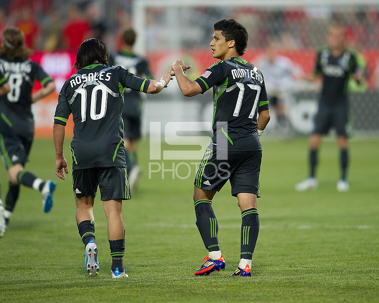 Seattle Sounders FC forward Fredy Montero #17 celebrates his game winning goal with Seattle Sounders FC midfielder Mauro Rosales #10 during an MLS game between the Seattle Sounders FC and the Toronto FC at BMO Field in Toronto on June 18, 2011..The Seattle Sounders FC won 1-0.
