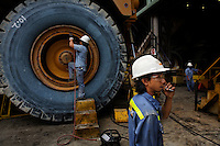 Batu Hijau gold mine and Benete seaport and concentrator and pipeline that takes tailings into ocean trench. Islamic woman driving truck that carries 240 tons of rock is Nurpiah (NB 1592).