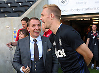 Manager Brendan Rodgers (L) of Swansea Legends during the Alan Tate Testimonial Match, Swansea City Legends v Manchester United Legends at the Liberty Stadium, Swansea, Wales, UK