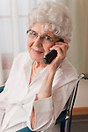 USA, Illinois, Metamora, Portrait of smiling senior woman on wheelchair talking on phone