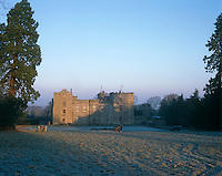 The bleak exterior of Chillingham Castle is softened in the light of a cold winter's morning