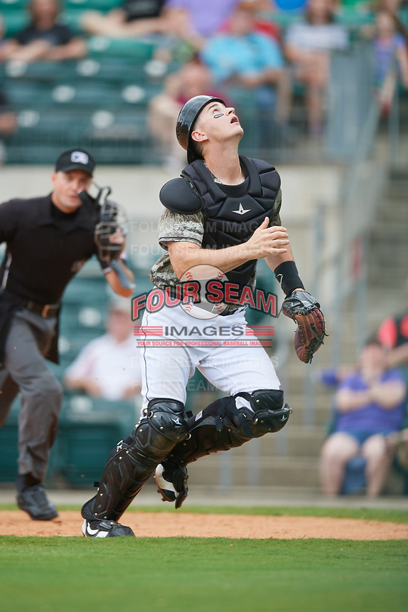 Arkansas Travelers catcher Marcus Littlewood tracks a pop up in front of home plate umpire Kyle Wallace during a game against the Frisco RoughRiders on May 28, 2017 at Dickey-Stephens Park in Little Rock, Arkansas.  Arkansas defeated Frisco 17-3.  (Mike Janes/Four Seam Images)