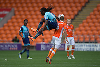 Marcus Bean of Wycombe Wanderers is beaten to the ball by Jim McAlister of Blackpool during the Sky Bet League 2 match between Blackpool and Wycombe Wanderers at Bloomfield Road, Blackpool, England on 20 August 2016. Photo by James Williamson / PRiME Media Images.