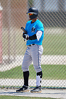 Miami Marlins centerfielder Víctor Víctor Mesa (32) on deck during a Minor League Spring Training game against the New York Mets on March 27, 2019 at the Roger Dean Stadium Complex in Jupiter, Florida.  (Mike Janes/Four Seam Images)