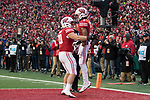 Wisconsin Badgers wide receiver Kendric Pryor (3) celebrates his touchdown reception with teammate Austin Ramesh (20) during an NCAA College Big Ten Conference football game against the Iowa Hawkeyes Saturday, November 11, 2017, in Madison, Wis. The Badgers won 38-14. (Photo by David Stluka)
