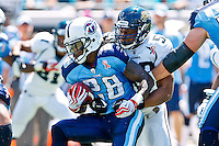 Sept 11, 2011:   Tennessee Titans running back Chris Johnson (28) is tackled by Jacksonville Jaguars linebacker Daryl Smith (52) during first half action between the Jacksonville Jaguars and the Tennessee Titans at EverBank Field in Jacksonville, Florida. Jacksonville defeated Tennessee 16-14.........