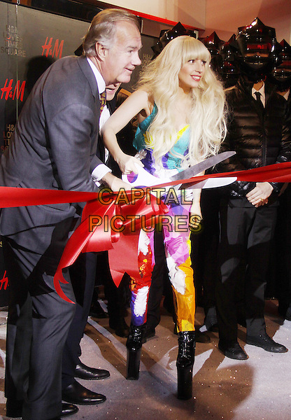 NEW YORK, NY - NOVEMBER 14: Lady Gaga at the midnight ribbon-cutting ceremony for the opening of the new H&amp;M Times Square store on November 14, 2013 in in New York City, NY., USA.<br /> CAP/MPI/RW<br /> &copy;RW/ MediaPunch/Capital Pictures