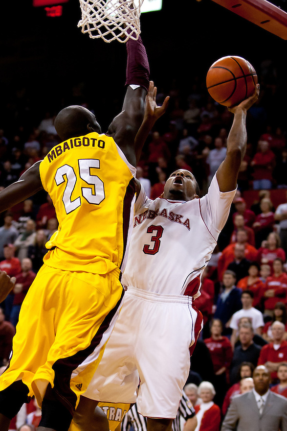 20 December 2011: Brandon Richardson #3 of the Nebraska Cornhuskers puts up a shot against Olivier Mbaigoto #25 of the Central Michigan Chippewas during the first half at the Devaney Sports Center in Lincoln, Nebraska. Nebraska defeated Central Michigan 72 to 69.