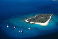 Caribbean island with sailboats aerial view sandy Cay Tortola British Virgin Islands