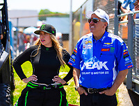 May 6, 2018; Commerce, GA, USA; NHRA top fuel driver Brittany Force (left) talks with father John Force during the Southern Nationals at Atlanta Dragway. Mandatory Credit: Mark J. Rebilas-USA TODAY Sports