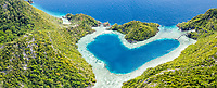 aerial view of a remote set of limestone islands with a heart-shaped, natural lagoon, Raja Ampat Islands, West Papua, Indonesia, Pacific Ocean