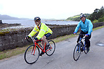 Louis Moriarty, The Sneem Hotel and Michael Murphy, Sneem, pictured arriving at the half way break at Kilmackillogue Harbour in County Kerry whilst taking part in the annual Sneem Cycle, &ldquo;Wild Atlantic Challenge Charity Cycle&rdquo; in aid of Breakthrough Cancer Research at the weekend.<br /> Photo Don MacMonagle<br /> <br /> repro free photo<br /> Further info: Ann O'Sullivan ann@breakthroughcancerresearch.ie