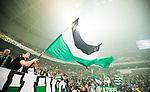 Stockholm 2014-09-28 Fotboll Superettan Hammarby IF - IK Sirius :  <br /> Hammarbys supportrar med en flagga i Tele2 Arena under matchen mellan Hammarby och Sirius <br /> (Foto: Kenta J&ouml;nsson) Nyckelord:  Superettan Tele2 Arena Hammarby HIF Bajen Sirius IKS supporter fans publik supporters