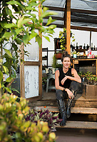 Lily Foster founder and Director of Huertos Concreto poses for a portrait on the office roof-top vegetable garden, Colonia Roma, Mexico City, Mexico