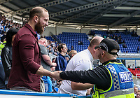 A Preston North End <br /> supporter conversing with a police officer.<br /> <br /> Photographer Andrew Kearns/CameraSport<br /> <br /> The EFL Sky Bet Championship - Reading v Preston North End - Saturday 30th March 2019 - Madejski Stadium - Reading<br /> <br /> World Copyright © 2019 CameraSport. All rights reserved. 43 Linden Ave. Countesthorpe. Leicester. England. LE8 5PG - Tel: +44 (0) 116 277 4147 - admin@camerasport.com - www.camerasport.com