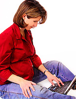 Beautiful pregnant woman working on laptop computer