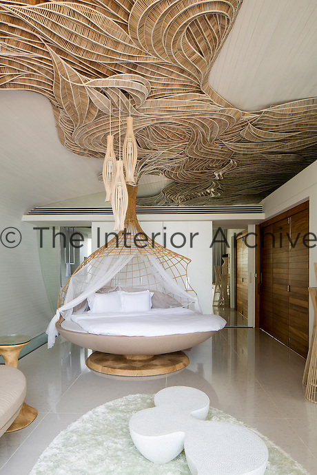 This bedroom in the Villa Siam at Iniala brings traditional Thai skills such as wicker weaving into the 21st century
