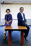 Tokyo, June 25 2013 - At Sakakura Associates achitecture office, Junzo Sakakura's children, Miho Sakakura Kida (left),  and Takenosuke Sakakura (right), sitting on a vintage table designed by Junzo Sakakura and Charlotte Perriand.