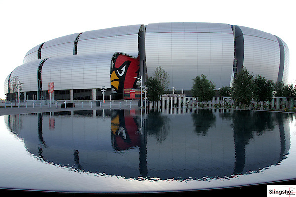 The Arizona Cardinals dedicate the outdoor pedestrian walkway ringing the stadium as Pat Tillman Freedom Plaza and unveil a bronze statue of the late Cardinal, as well as add a reflection pool in his honor before game against the Dallas Cowboys, Nov. 12, 2006, at University of Phoenix Stadium, in Glendale, AZ.