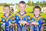 WINNERS MEDALS: Showing of their Gold medals at the Ballymac GAA Family Fun Day at the Ballymac grounds on Sunday l-r: Brian Lonergan, Gary Horan and Colin McDaid.