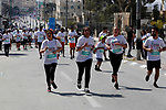 Palestinian and foreign activsts take part in the Palestine Marathon, in the West Bank city of Bethlehem, Friday, March 22, 2019. Palestine seventh international marathon kicked off this morning in Bethlehem with the participation of 8000 runners from 76 countries, with a 51.7 percent of women participants, according to the marathon organizers. Photo by Wisam Hashlamoun