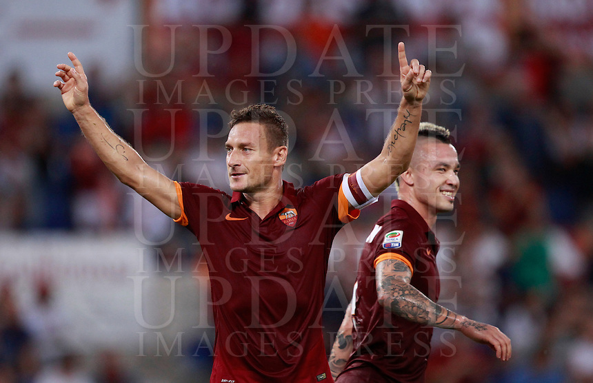 Calcio, Serie A: Roma vs ChievoVerona. Roma, stadio Olimpico, 18 ottobre 2014.<br /> Roma's Francesco Totti celebrates past teammate Radja Nainggolan, right, after scoring on a penalty kick during the Italian Serie A football match between Roma and ChievoVerona at Rome's Olympic stadium, 18 October 2014.<br /> UPDATE IMAGES PRESS/Isabella Bonotto