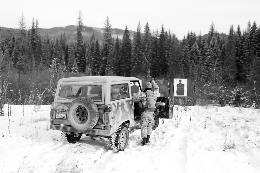 After checking targets for accuracy, a member of the Idaho Light Foot Militia hops into a camouflage jeep to head back to a nearby camp in Priest River, Idaho.