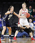 SIOUX FALLS, SD - MARCH 7:  Tia Hemillier #4 of South Dakota looks to drive past defender Maria Martianez #44 of Oral Roberts in the 2016 Summit League Tournament. (Photo by Dick Carlson/Inertia)