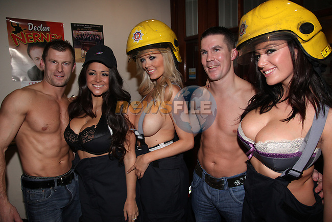 Nuts Girls Malene Espensen (Blonde) Lindsey Strutt and Casey Batchelor Launching the Drogheda Fire and rescue service calender 2010 at the earth night club in Drogheda.Pictured are Drogheda Fire Service members Dylan Kiely and Damien McKenna..Photo: Fran Caffrey/www.newsfile.ie...