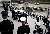 A U.S. military honor guard team carries the flag draped casket of former U.S. President George H. W. Bush from the U.S. Capitol December 5, 2018 in Washington, DC. A funeral service will be held today for former U.S. President H.W. Bush at the Washington National Cathedral. President Bush will be buried at his final resting place at the George H.W. Bush Presidential Library at Texas A&amp;M University in College Station, Texas. A WWII combat veteran, Bush served as a member of Congress from Texas, ambassador to the United Nations, director of the CIA, vice president and 41st president of the United States. <br /> CAP/MPI/RS<br /> &copy;RS/MPI/Capital Pictures