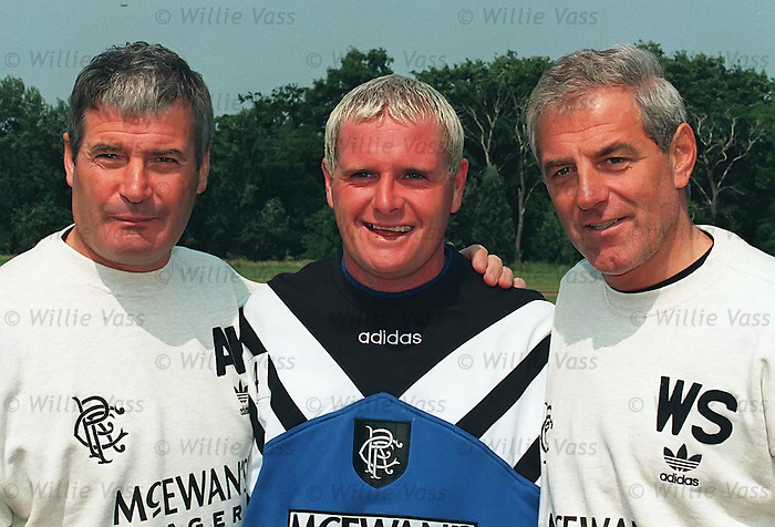 Paul Gascoigne reports for training on his first day at Rangers with Archie Knox and Walter Smith in Bellahouston Park 20th July 2005