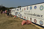 "East Meadow, New York, U.S. 11th September 2013. Young and old visitors visit the Global War on Terror ""Wall of Remembrance"" a traveling memorial on display in New York for the first time, at Eisenhower Park on the 12th Anniversary of the terrorist attacks of 9/11. The unique 94 feet long by 6 feet high wall has, on one side, almost 11,000 names of those lost on September 11, 2001, along with heroes and veterans who lost their lives defending freedom of Americans over past 30 years. On the wall's other side is a timeline, with photos, covering 1983 to present day."